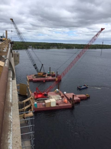 Dual crane on barges for containment