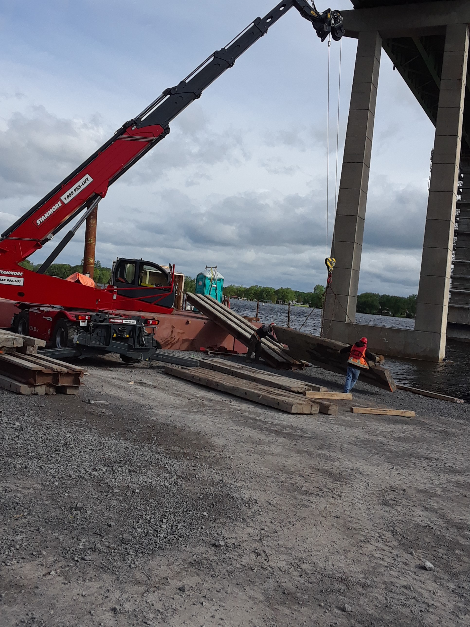 Preparing ramps on to the barge for crane