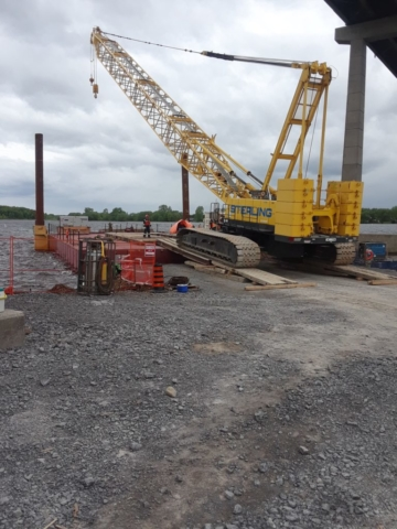 200 ton crane being loaded on the barge