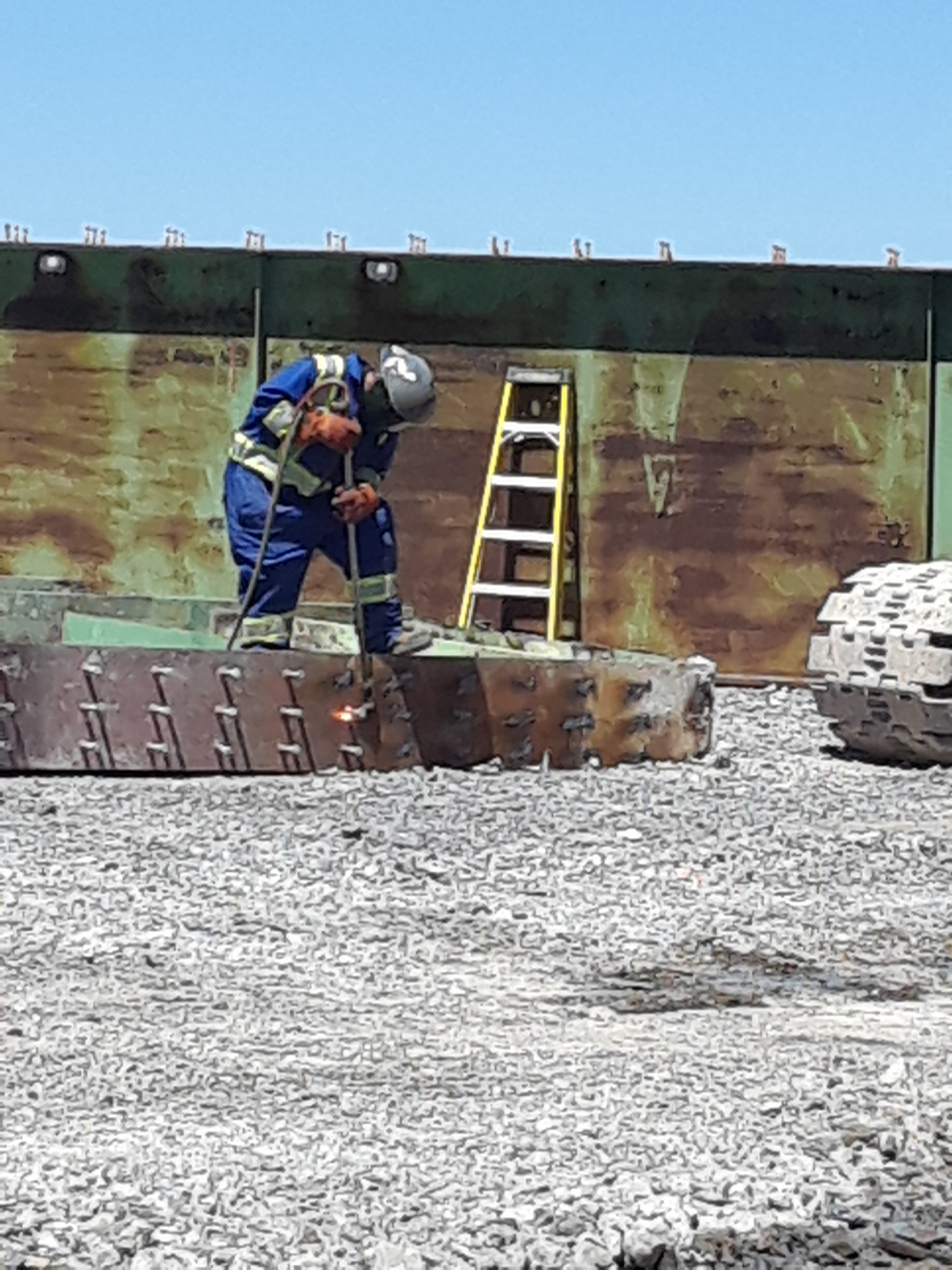 Section of girder being cut for removal from site