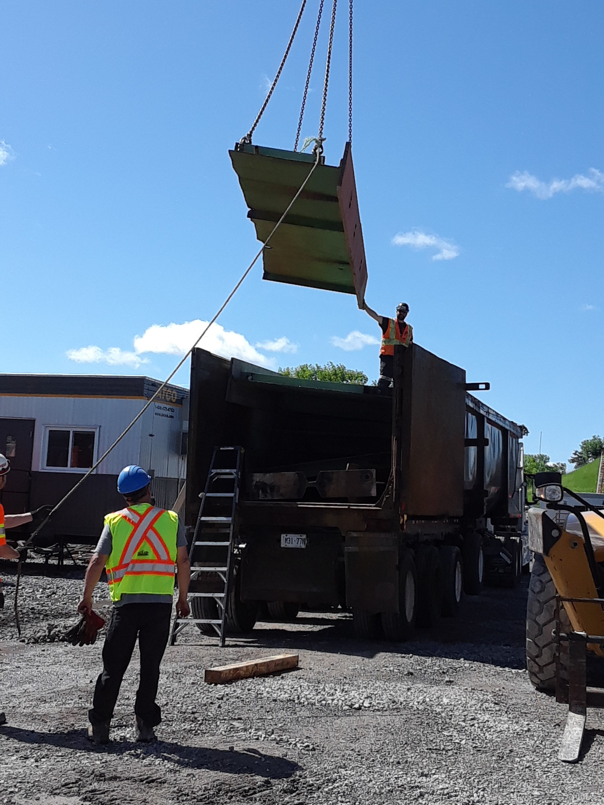 Removal of dismantled girders from project site