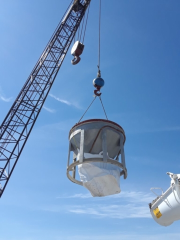 Concrete being lifted to deliver to pier top