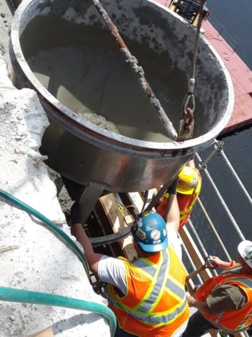 Concrete being poured in to the form