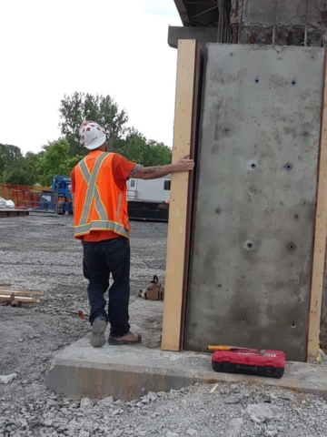 Concrete forms being removed after concrete is cured
