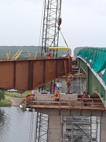 New girder being lowered onto pier cap