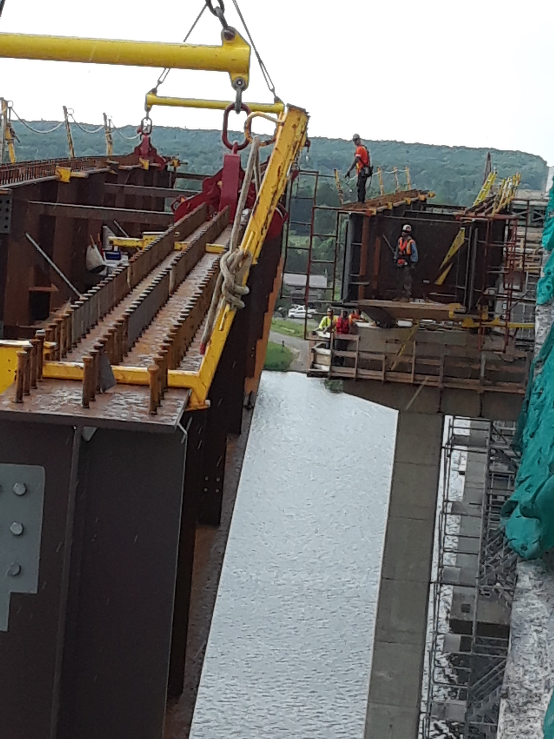 Girder being lowered into place
