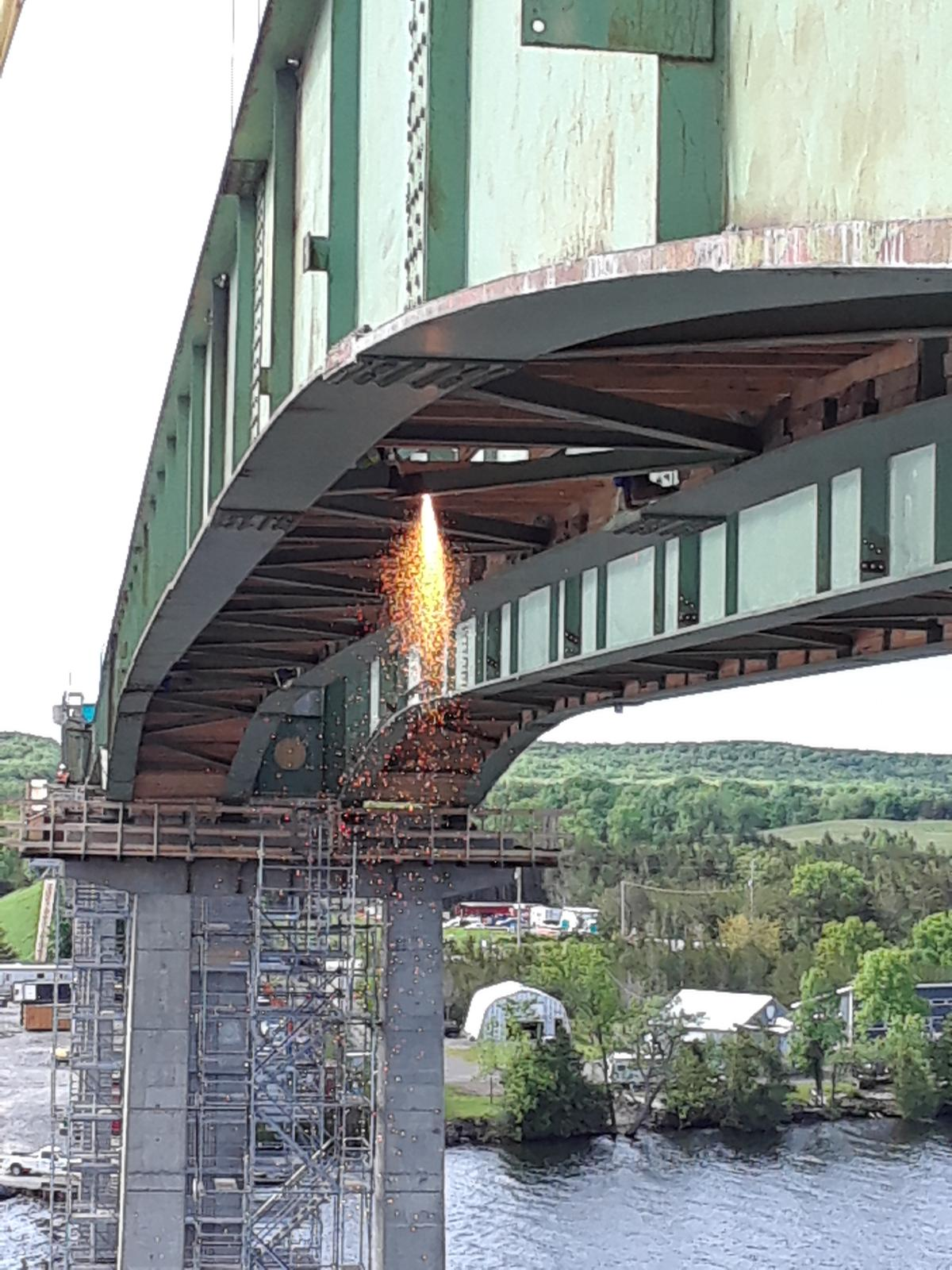 Girder bracing being cut for removal
