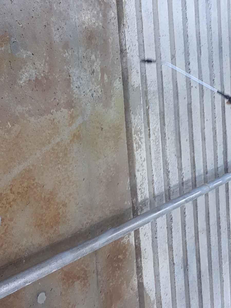 Spraying concrete sealer