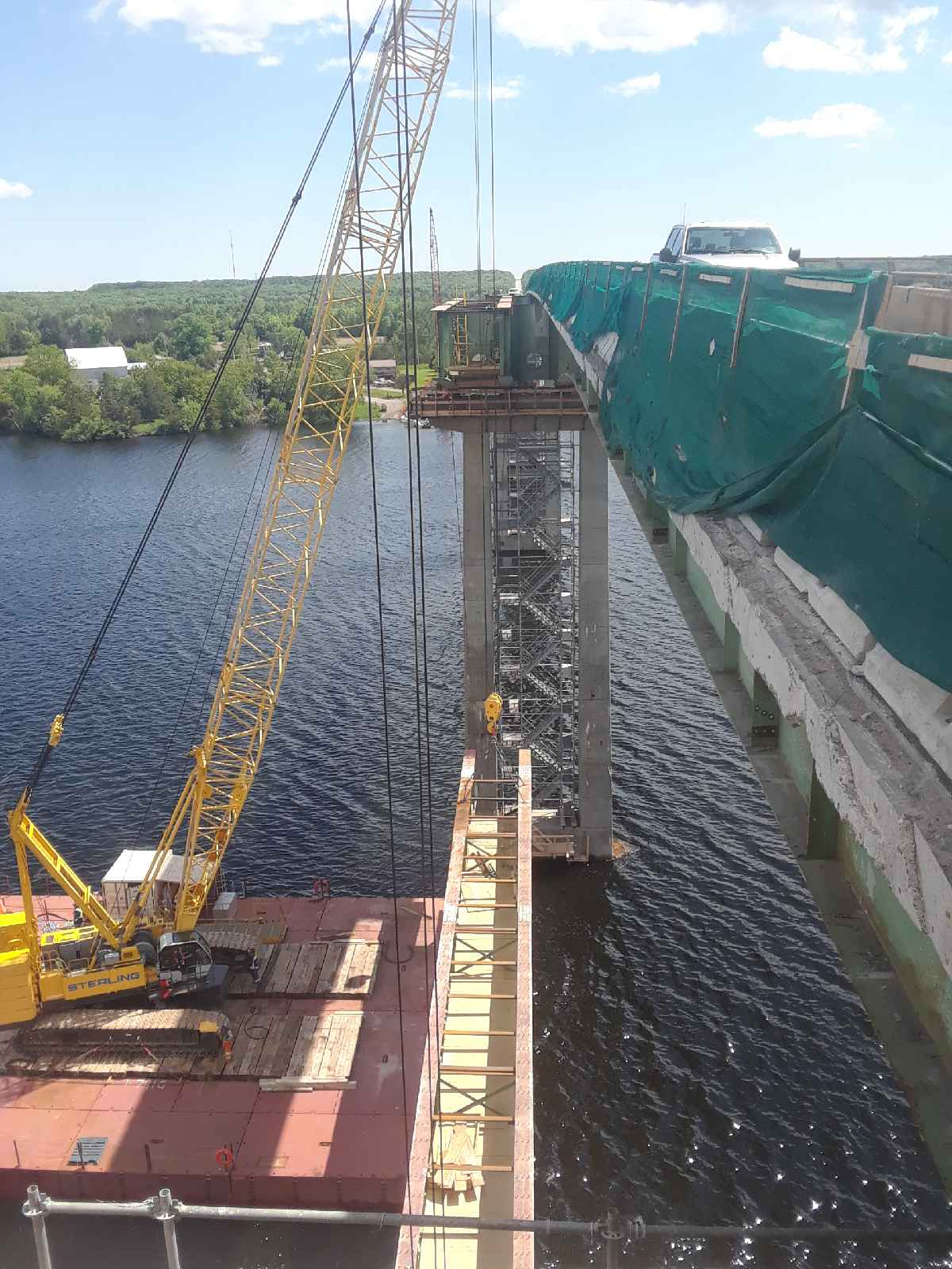 Fourth girder removal lowering on to the barges