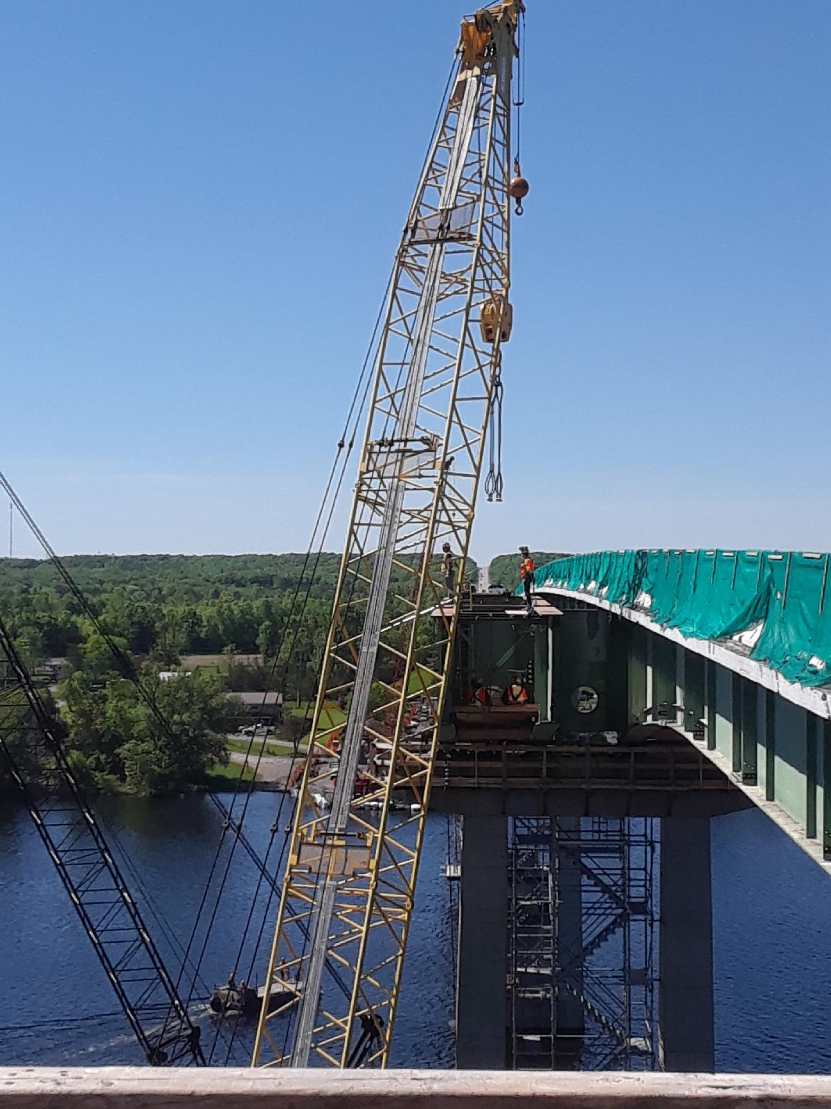 Cutting and hooking up crane cables to girder for removal
