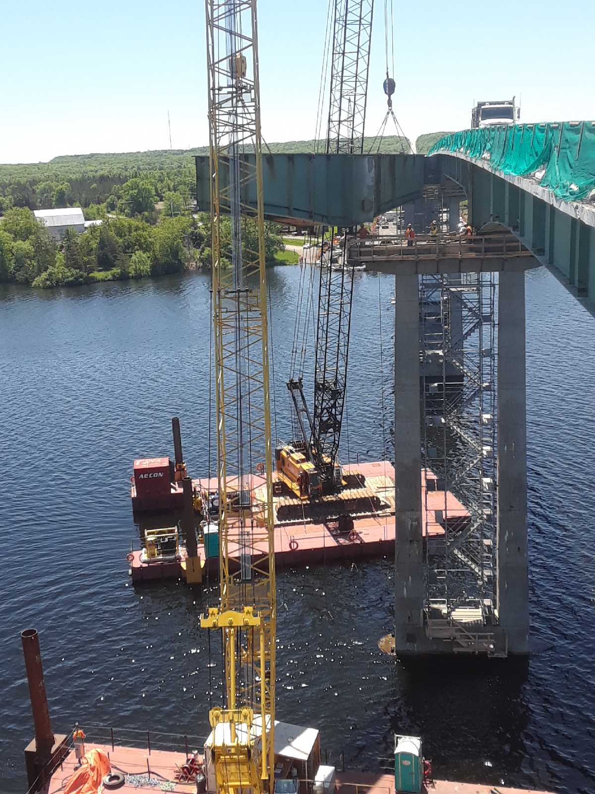 Girder being lifted from pier and lowered