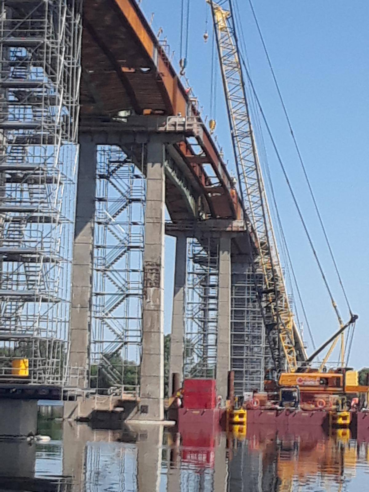 Girder section secured in-place