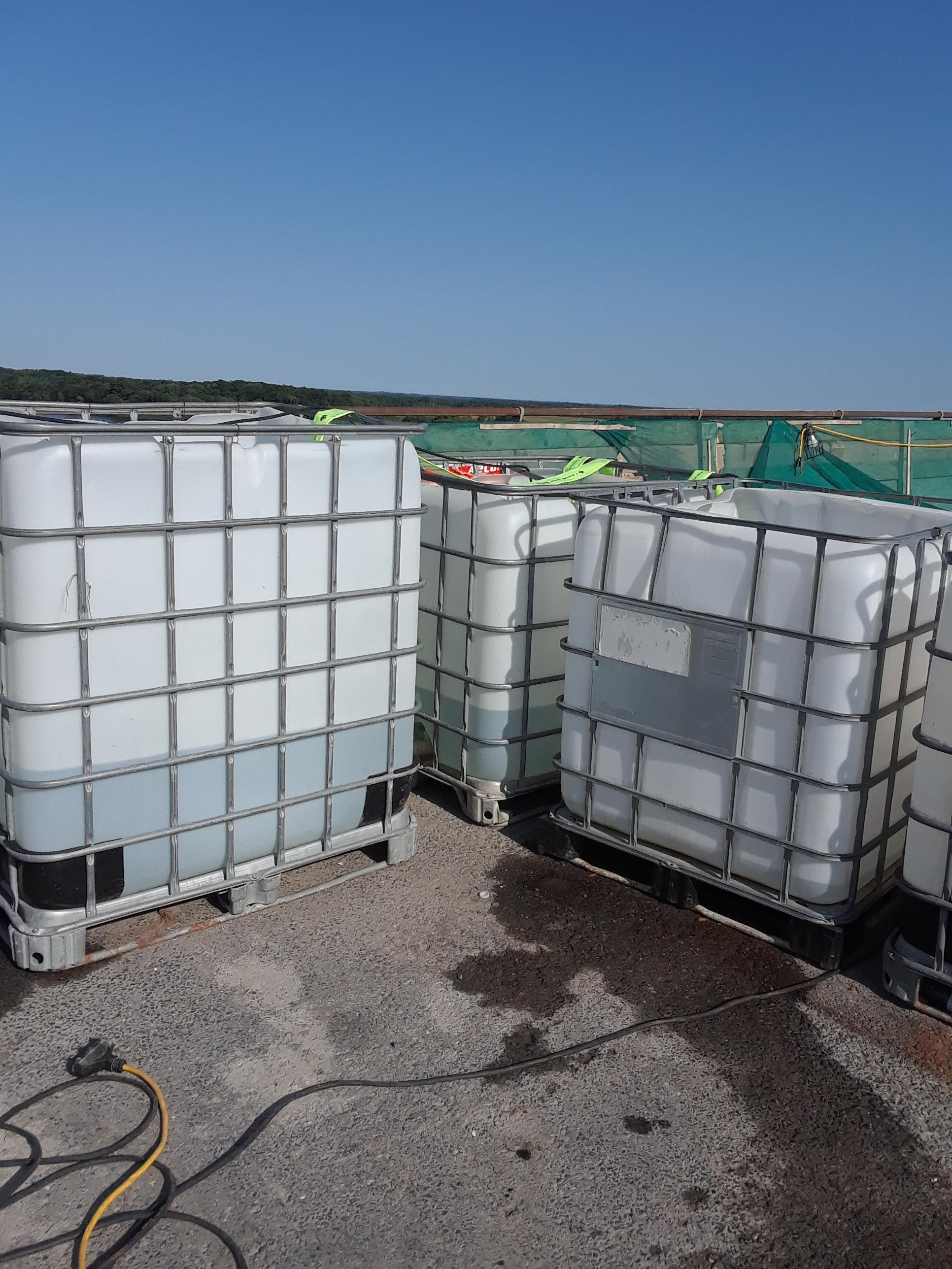 Water holding tanks to keep the fresh concrete wet