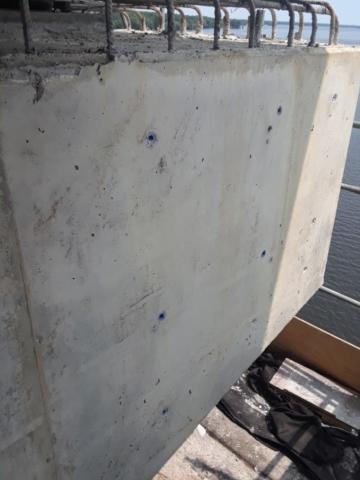 New concrete facing at pier cap