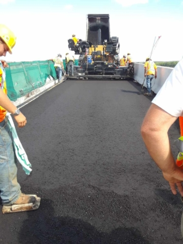Finishing the first lift of asphalt