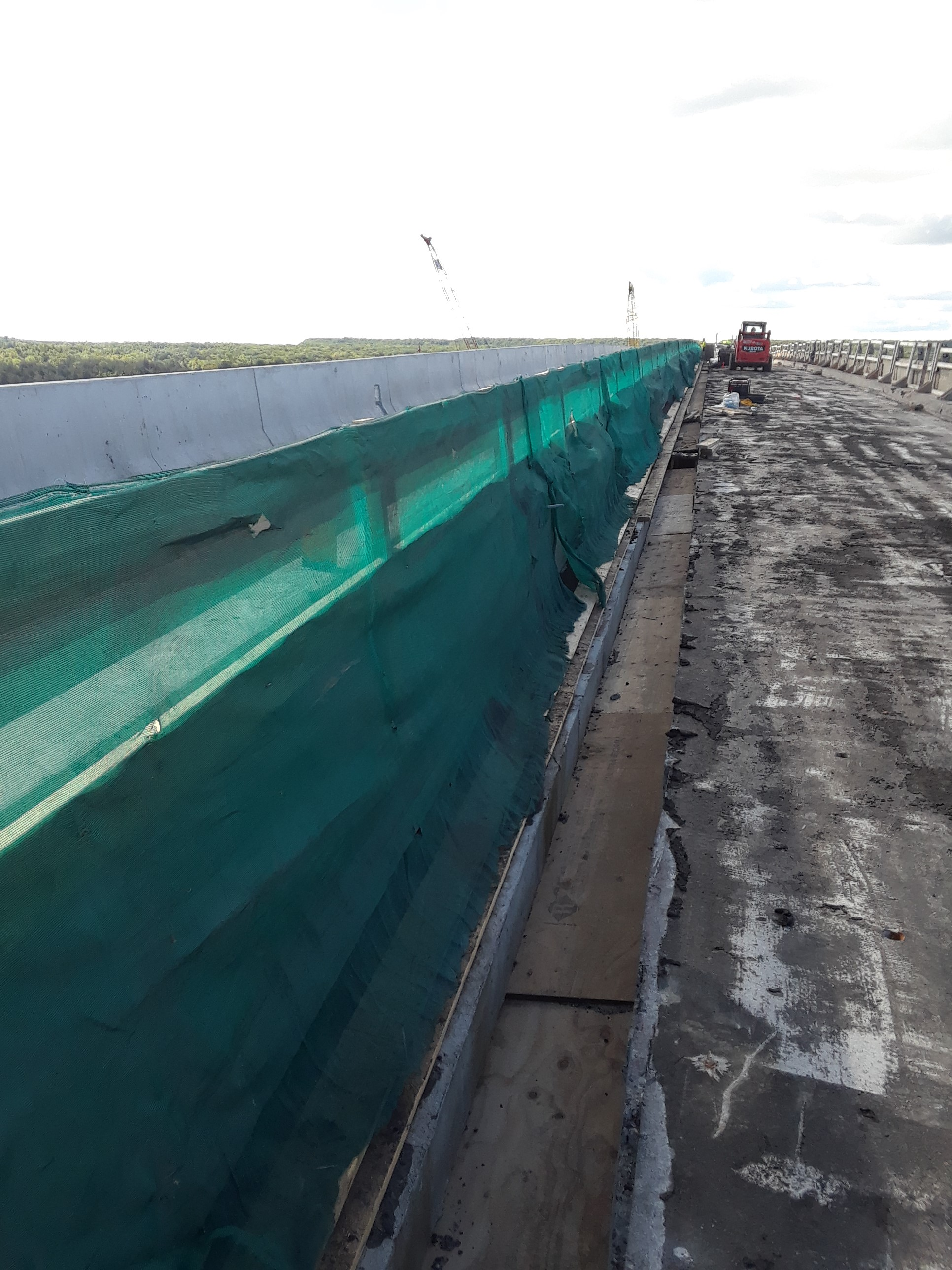 Green construction fencing on TBC for debris/safety control