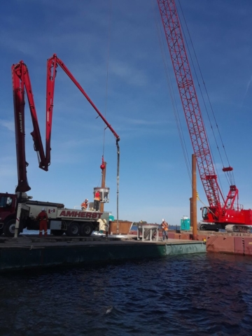 View of the two barges housing one of the cranes and the concrete pump truck