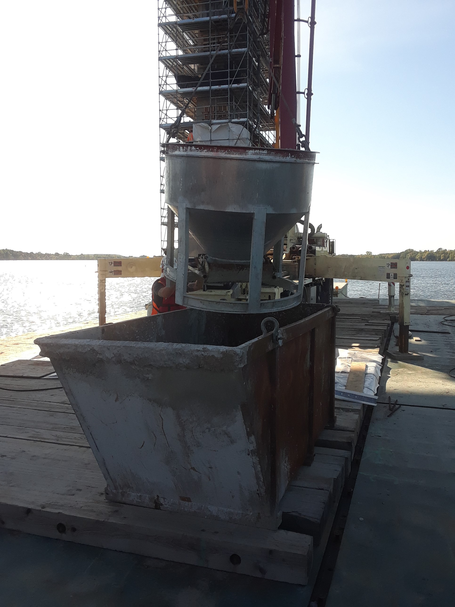 Unused concrete being removed from bucket