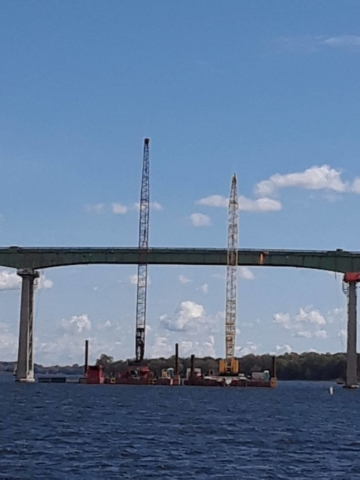 Cranes in place while the girder is being cut for removal