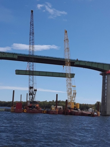 First section of girder starting to be lowered
