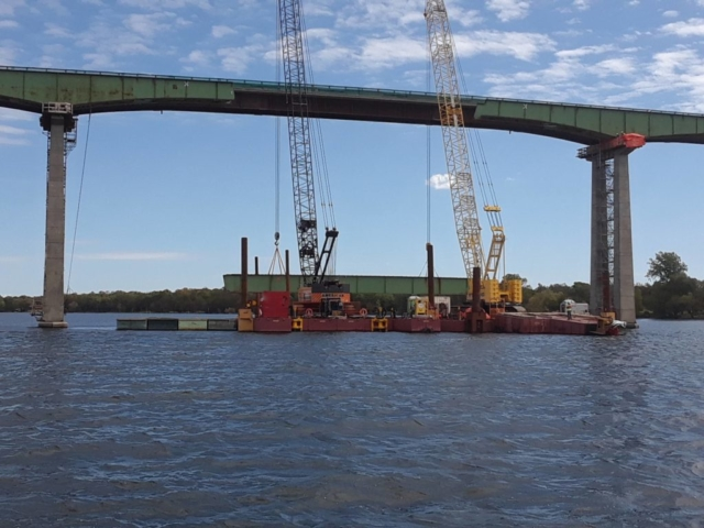 Girder about to lowered onto the barge