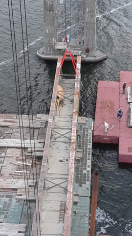 Girder being placed on the barge