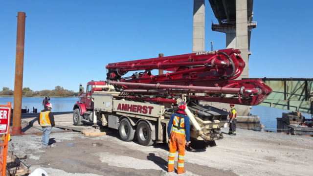 Concrete pump truck being loaded on the barge for concrete placement