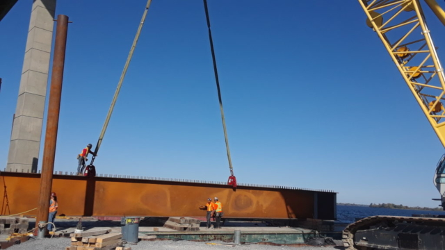 New girder being placed on barge to be assembled
