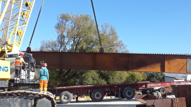 New girder being delivered and removed from the truck