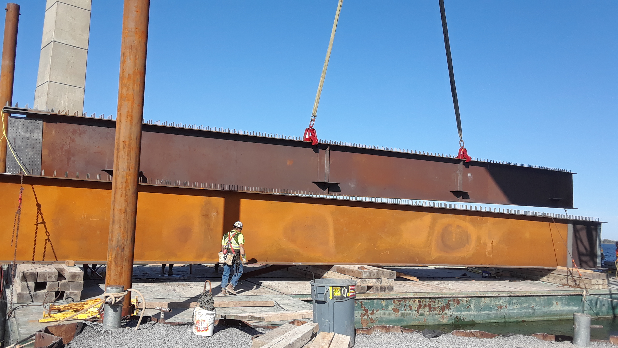 Second section of the girder being moved into place to be assembled