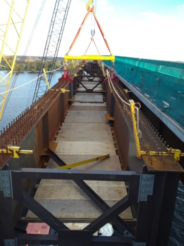 Approach girder being lowered into place / top view