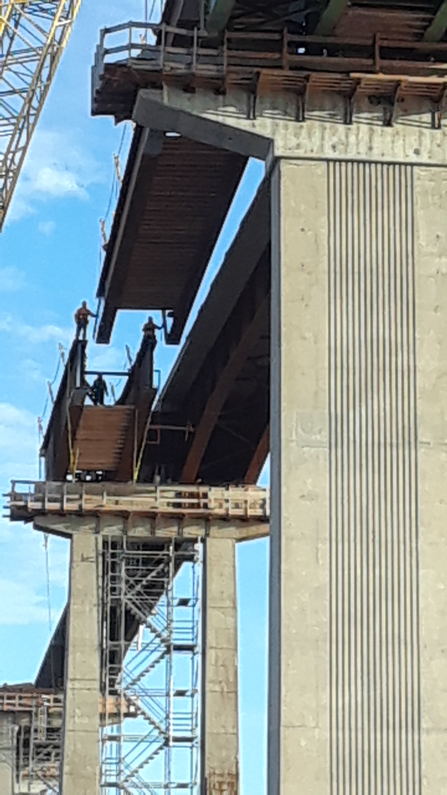 Approach girder being lowered into place / view from below