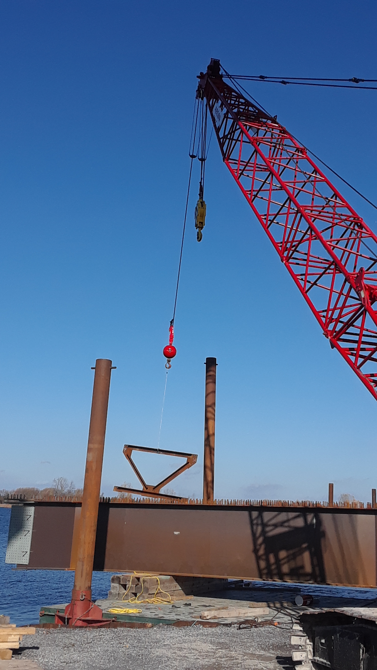Bracing being lowered into girder sections for assembly