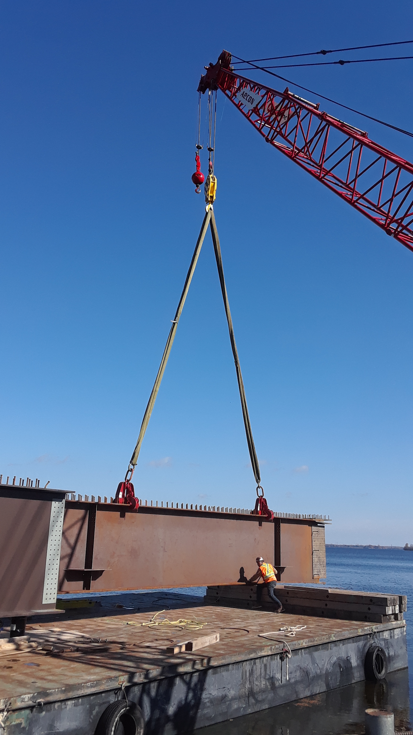 Placing girder section on to the barge for assembly