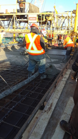 Concrete being pumped into the deck forms