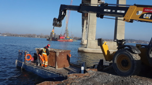 Container of concrete slurry being removed from the boat