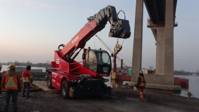 Telescopic handler being removed from the barge
