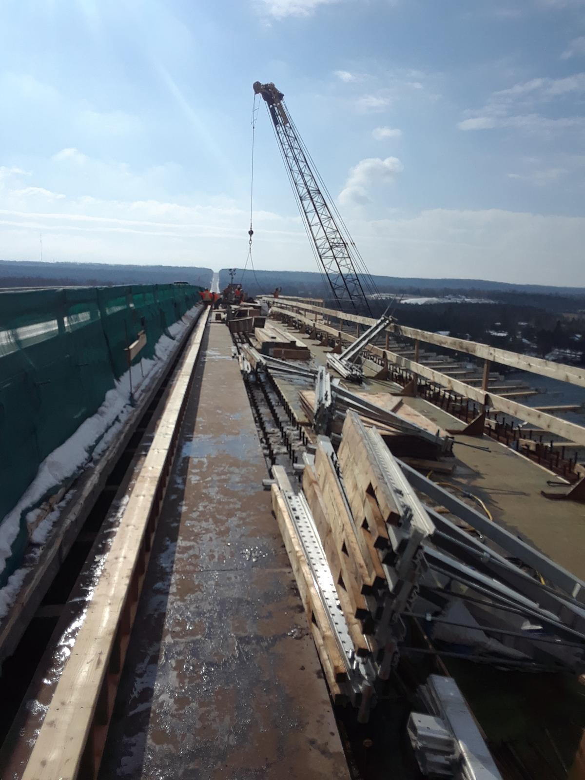 Brackets and material being lifted to the deck