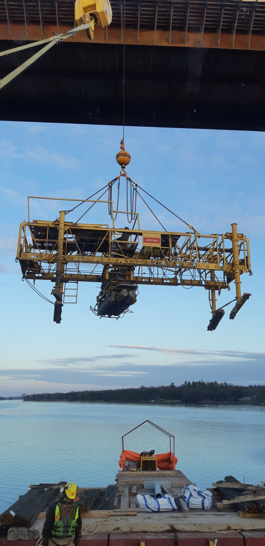 Concrete finisher lifted to deck