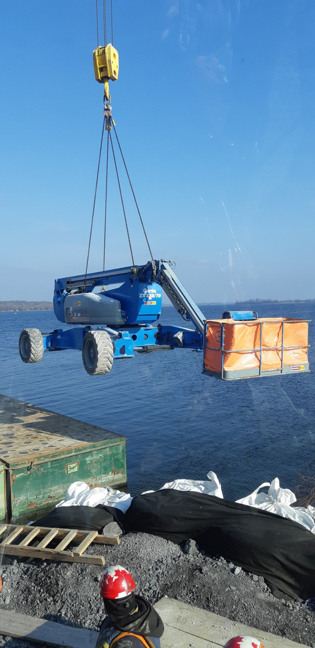 Man lift being removed from the barge
