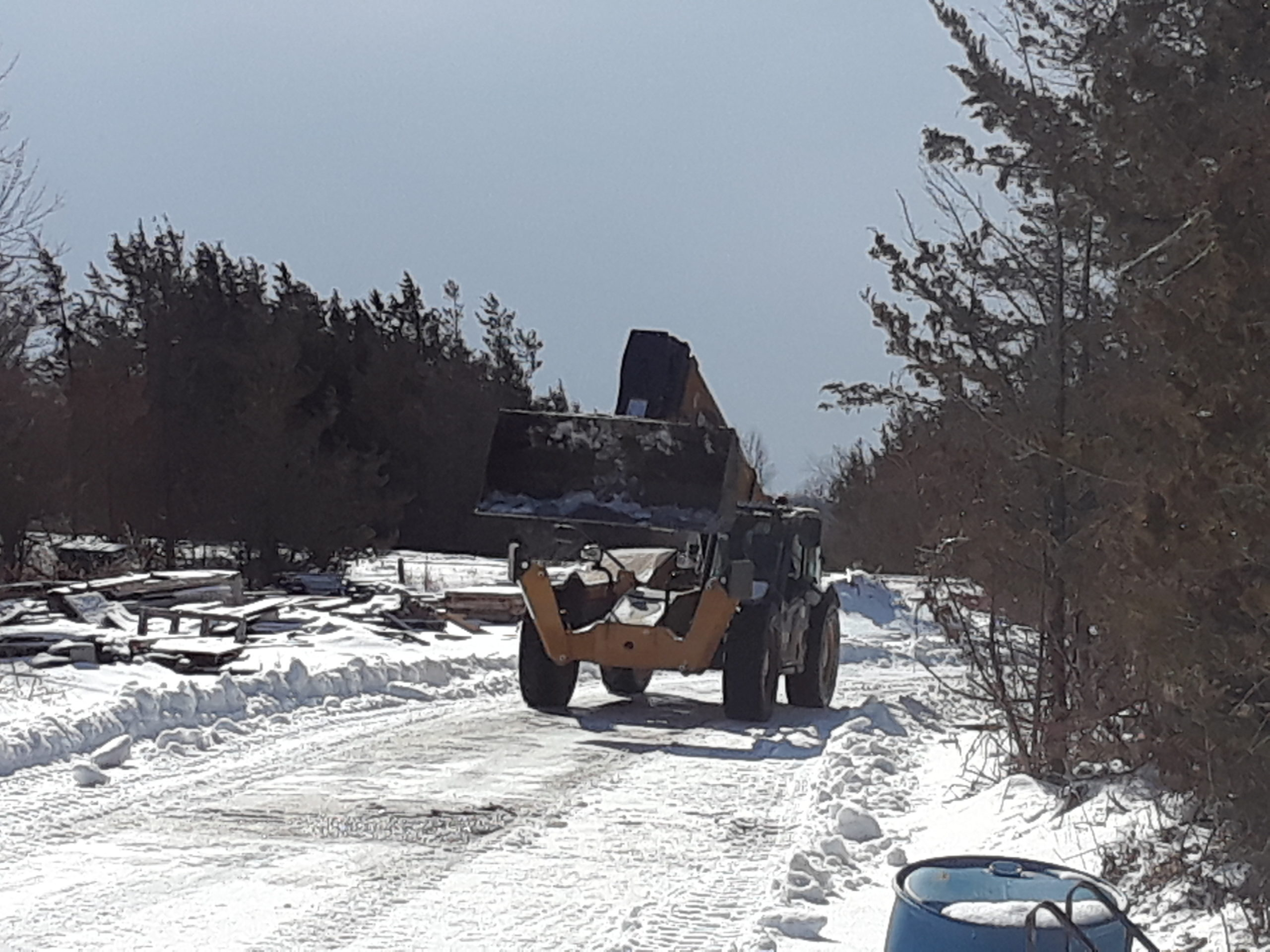 Plowing the snow in the construction yard