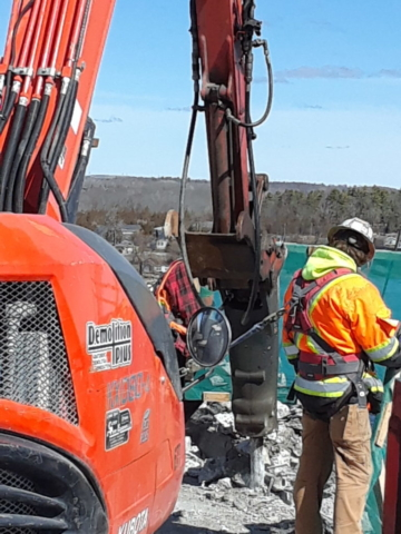 Excavator chipping overhang for removal