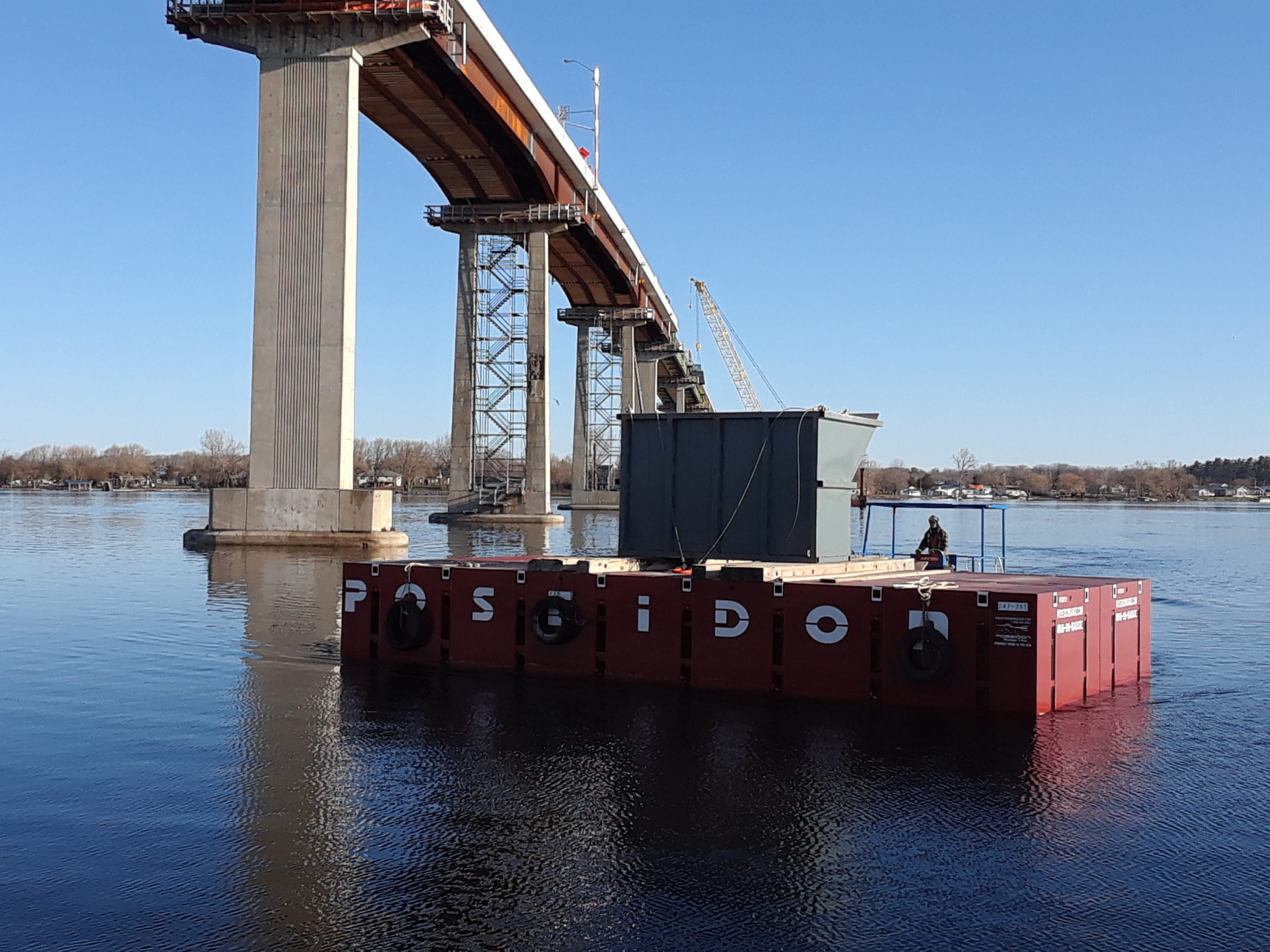 Containment bin being brought to shore by the barge
