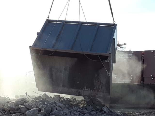Concrete ruble being removed from the containment bin
