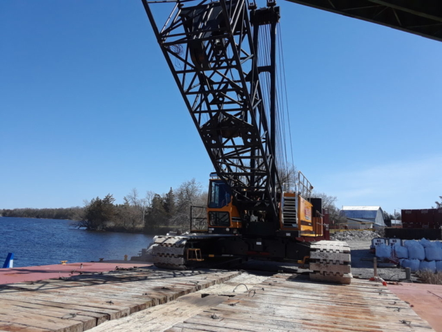 Second 200 ton crane being loaded onto a barge