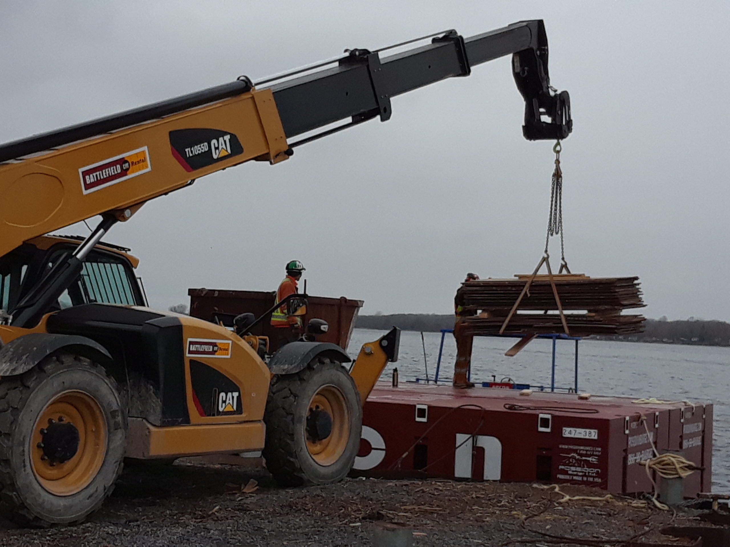 Removed form-work being offloaded from the barge