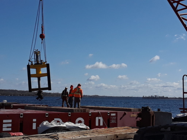 Lowering the propulsion unit for installation on the barge