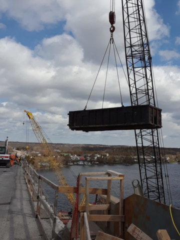 One of the empty ruble bins being lifted by the crane to the deck