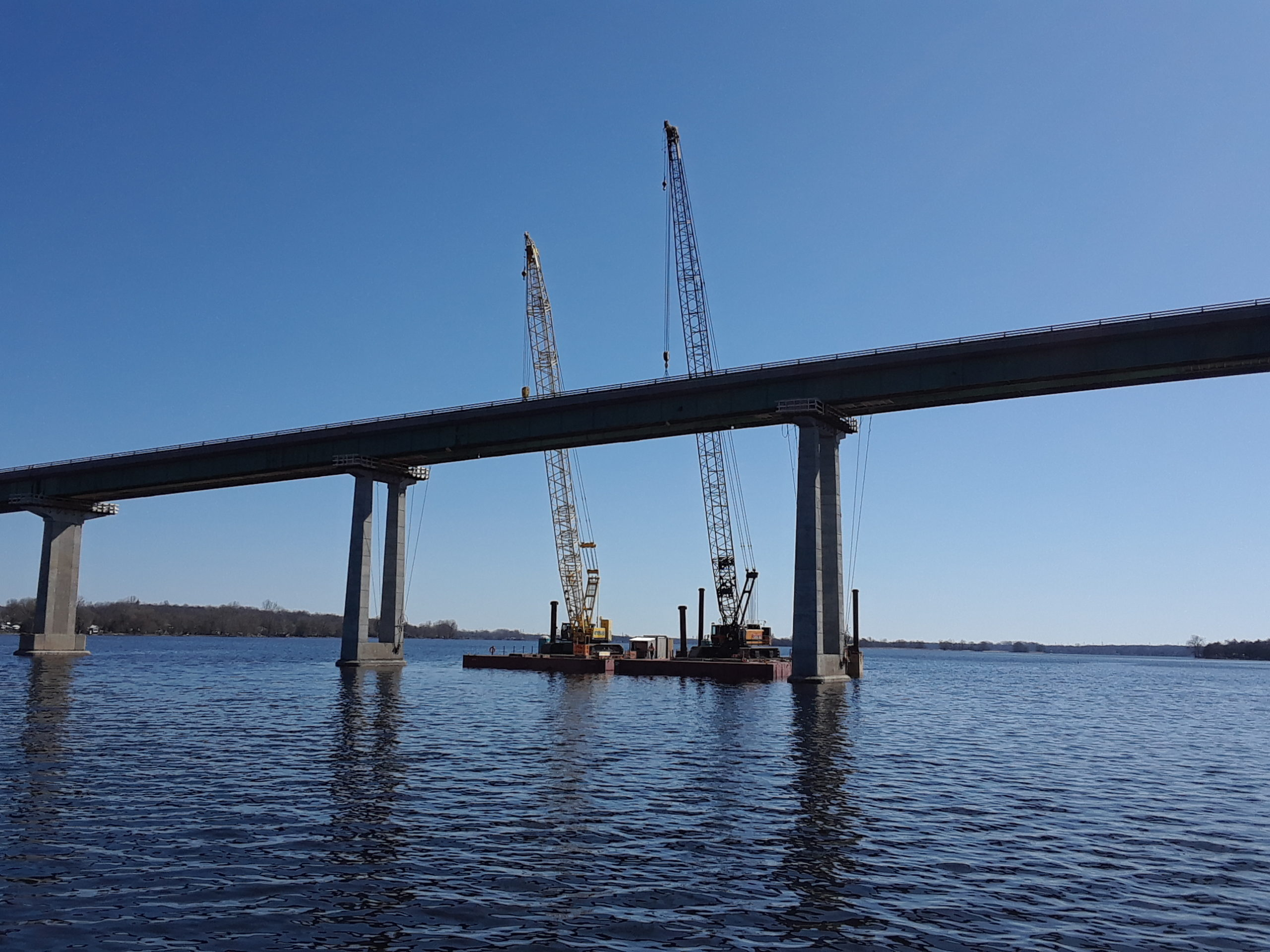 200 ton cranes connected to the first section of girder for removal