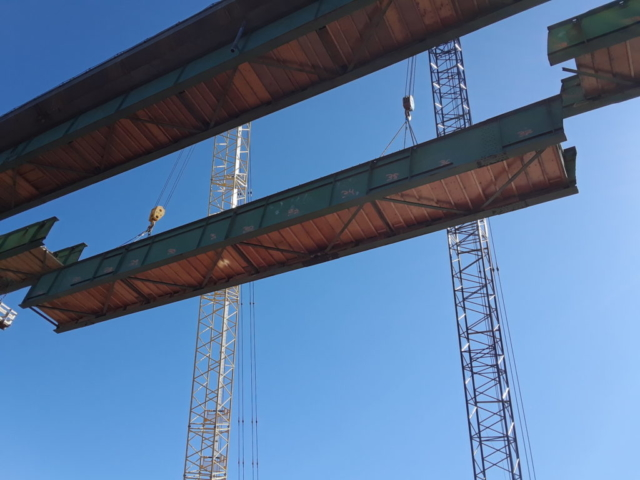First section of girder being lowered to the barge